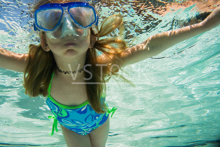 Cassidy Vote horizontal child pool lifestyle outside outdoor girl female kid childhood person underwater water swimming swim suit swimsuit bathing tourism travel vacation vacationing trip sport recreation recreational active activity activities summer summertime tropics tropical fun leisure pleasure goggles mask