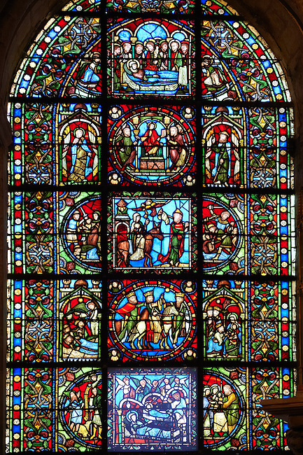 Medieval Gothic stained glass window showing  scenes from the life of Jesus Christ (from Bottom Up) The nativity, The journey of the 3 Kings, the flight to Egypt and the dormition of the Virgin. From the Chapel of The Virgin,  Cathedral Basilica of Saint Denis ( Basilique Saint-Denis ) Paris, France. A UNESCO World Heritage Site.