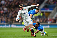 Elliot Daly of England takes on the Italy defence. Guinness Six Nations match between England and Italy on March 9, 2019 at Twickenham Stadium in London, England. Photo by: Patrick Khachfe / Onside Images