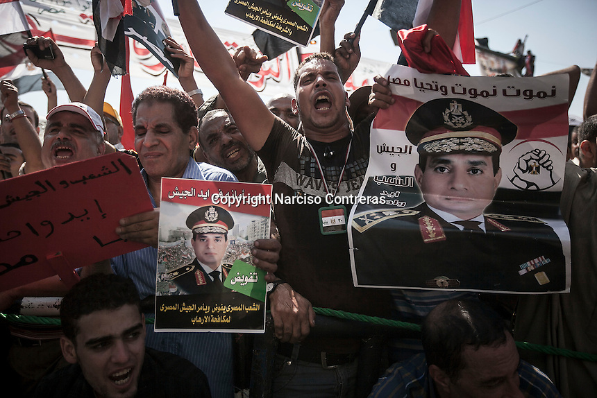 In this Friday, Jul. 26, 2013 photo, pro Sisi protesters demonstrate during a rally Tahrir aquare in Cairo. (Photo/Narciso Contreras).