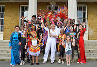 July 21, 2012: British Sign Language user Olive Lycett of Hackney, poses with the Olympic torch and members of the community during a ceremony at Clissold Park, located in Stoke Newington, London, England.
