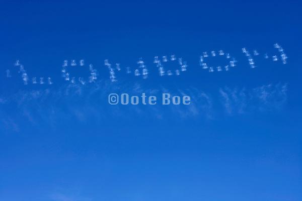 the word LONDON written in the sky
