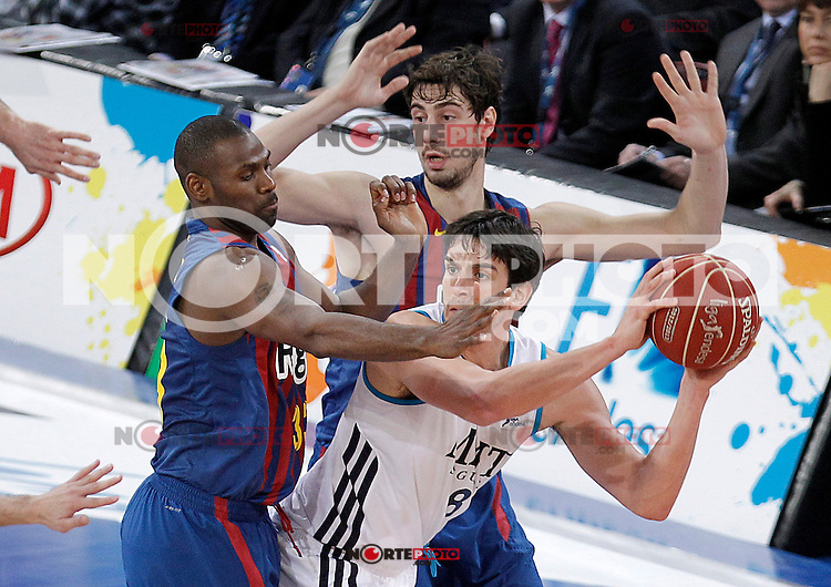Real Madrid's Carlos Suarez (c) and FC Barcelona Regal's Pete Mickeal (l) and Ante Tomic during Spanish Basketball King's Cup match.February 07,2013. (ALTERPHOTOS/Acero) /Nortephoto
