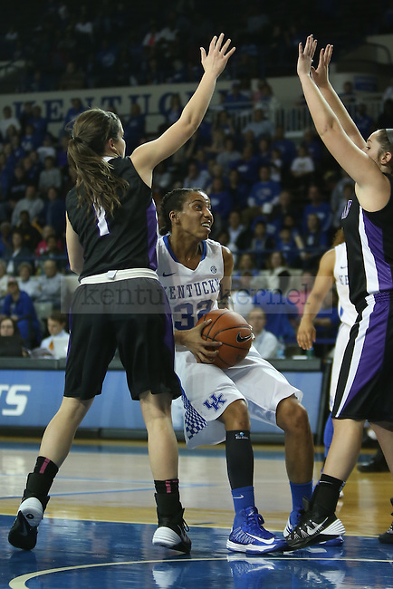 Kentucky Wildcats guard Kastine Evans (32) fighting for the basket during the first half of the UK Hoops basketball game vs. Lipscomb on Thursday, November 21, 2013, in Lexington, Ky. Photo by Kalyn Bradford | Staff