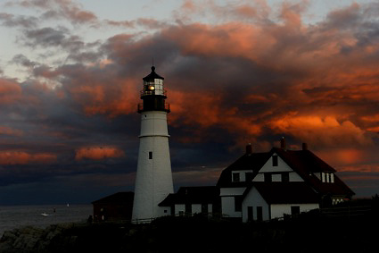 This is a rare image made at sunset at Portland Head Light in Cape Elizabeth, Maine. The photograph is quietly exposed revealing all the detail in a mammoth cloud formation. You are looking east as the sun sets behind the camera, illuminating the wonderful clouds.