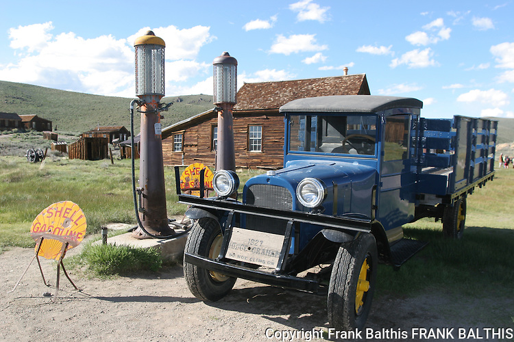 Blue trucks and gas pumps in Bodie SHP