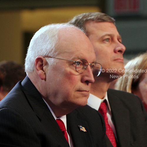 Washington, DC - December 19, 2008 -- Chief Justice of the United States John Roberts, right, sits next to United States Vice President Dick Cheney, left, Friday, December 19, 2008 during the unveiling of National Portrait Gallery portraits of US President George W. Bush and First Lady Laura Bush at the National Portrait Gallery in Washington, D.C..Credit: Ken Cedeno / Pool via CNP