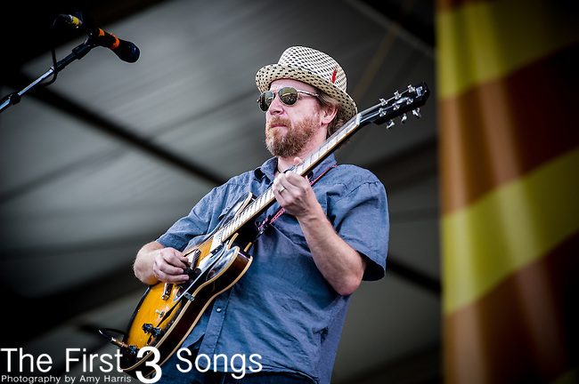 Jake Eckert of the New Orleans Suspects performs during the New Orleans Jazz & Heritage Festival in New Orleans, LA.