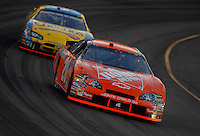 Apr 22, 2006; Phoenix, AZ, USA; Nascar Nextel Cup driver Tony Stewart of the (20) Home Depot Chevrolet Monte Carlo leads Bobby Labonte during the Subway Fresh 500 at Phoenix International Raceway. Mandatory Credit: Mark J. Rebilas-US PRESSWIRE Copyright © 2006 Mark J. Rebilas..