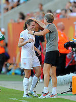 Pia Sundhage (r) and Heather O'Reilly of team USA during the FIFA Women's World Cup at the FIFA Stadium in Dresden, Germany on June 28th, 2011.