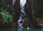 Alaska, sea kayaker, Baranoff Island, Fjord, waterfall dwarfs kayaker, Southeast Alaska, .