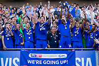 Sol Bamba of Cardiff City lifts the trophy as his side celebrate promotion after the Sky Bet Championship match between Cardiff City and Reading at the Cardiff City Stadium, Cardiff, Wales on 6 May 2018. Photo by Mark  Hawkins / PRiME Media Images.