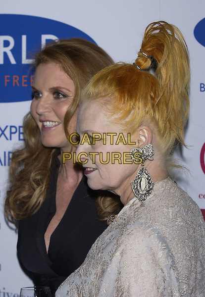SARAH FERGUSON, DUCHESS OF YORK & VIVIENNE WESTWOOD.The Cosmetic Executive Women (UK) Achiever Awards 2004, The Mirror Room, Claridge's, .London, October 27th 2004..portrait headshot earrings large big drop .Ref: PL.www.capitalpictures.com.sales@capitalpictures.com.©Capital Pictures.