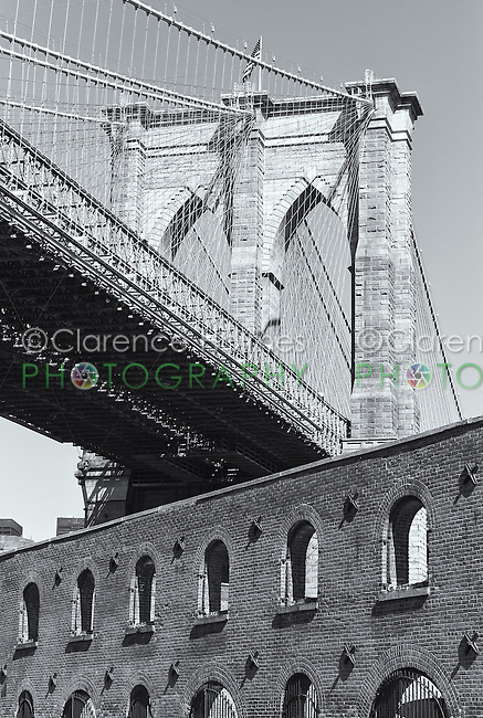 The Brooklyn Bridge and the Tobacco Warehouse from Water Street in Brooklyn, New York