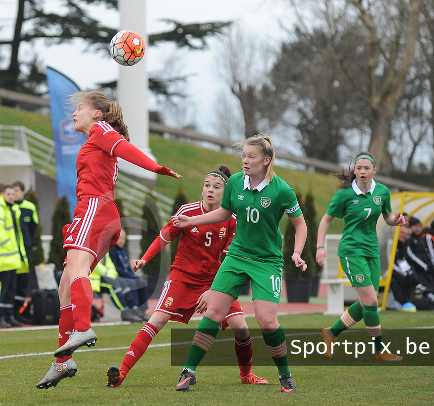 20160319 - BAYEUX , FRANCE : Irish Saoirse Noonan (10) with Hungarian Brigitta Pulins (L) and Anna Julia Csiki (5) pictured during the soccer match between the women under 17 teams of The Republic of Ireland and Hungary , on the first matchday in group 3 of the UEFA Women Under17 Elite rounds at Stade Henry Jeanne in Bayeux , France . Saturday 19th March 2016 . PHOTO DIRK VUYLSTEKE