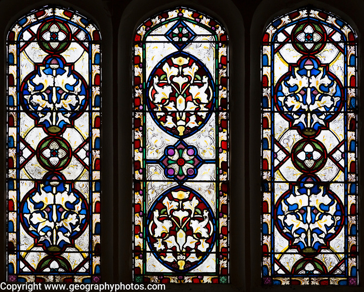 Nineteenth century decorative stained glass window with floral geometric pattern based on lilies, Easton Royal, Wiltshire