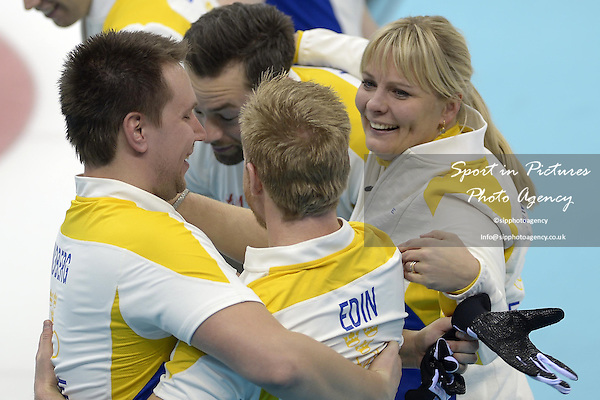 The Swedish team celebrate. (l to r)  Fredrik Lindberg (SWE), Sebastian Kraupp (SWE, vice skip), Niklas Edin (SWE, skip) and Swedish coach Eva Lund. Mens curling - Bronze medal match - SWE v CHN - Ice Cube Curling Centre - Olympic Park - PHOTO: Mandatory by-line: Garry Bowden/SIPPA/Pinnacle - Photo Agency UK Tel: +44(0)1363 881025 - Mobile:0797 1270 681 - VAT Reg No: 768 6958 48 - 210214 - 2014 SOCHI WINTER OLYMPICS - Ice Cube Curling Centre, Sochi, Russia