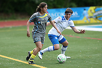 Philadelphia midfielder, Christina DiMartino (5), is challenged by Boston Breaker defender, Amy LePeilbet (6).  The Philadephia Independence prevailed, 2-0 on a beatiful Mother's Day evening at Widener University in Chester, PA.