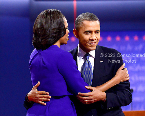 United States President Barack Obama, the Democratic Party nominee for President, embraces his wife, first lady Michelle Obama following the first Presidential Debate of the 2012 General Election against former Massachusetts Governor Mitt Romney, the Republican Party nominee for President, at the University of Denver in Denver, Colorado on Tuesday, October 2, 2012..Credit: Ron Sachs / CNP.(RESTRICTION: NO New York or New Jersey Newspapers or newspapers within a 75 mile radius of New York City)