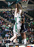 North Texas Mean Green center Ben Knox (15) goes for a slam dunk in the game between the Jackson State Tigers and the University of North Texas Mean Green at the North Texas Coliseum,the Super Pit, in Denton, Texas. UNT defeated Jackson 68 to 49