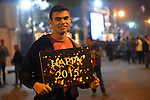 An Egyptian Christian celebrates of Christmas and New Year festivities, in Cairo on December 31, 2014. Photo by Amr Sayed