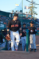 San Jose Giants right fielder Bryce Johnson (23) jogs onto the field with a Pee Wee League baseball player before a California League game against the Visalia Rawhide on April 12, 2019 at San Jose Municipal Stadium in San Jose, California. Visalia defeated San Jose 6-2. (Zachary Lucy/Four Seam Images)