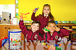 Ruben Wall Griffin, Gabja Dackauskyte and Samuel Koky pictured on their first day of school at moyderwell primary, Tralee on Thursday.