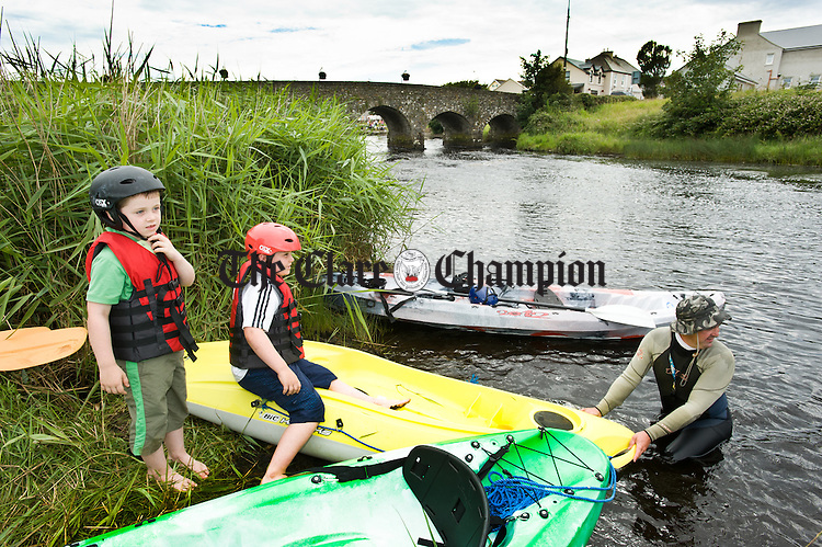 Eoin and Cillian Hassett, with David Ryan of Doonbeg Ocean Evolution  about to take to the river during the kayak trials held as part of the Doonbeg Seafood Festival. Photograph by John Kelly,