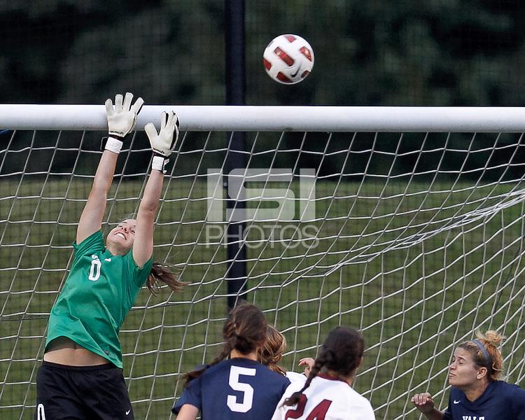 Yale University goalkeeper Rachel Ames (0) corner kick action. In overtime, Harvard University defeated Yale University,1-0, at Soldiers Field Soccer Stadium, on September 29, 2012.