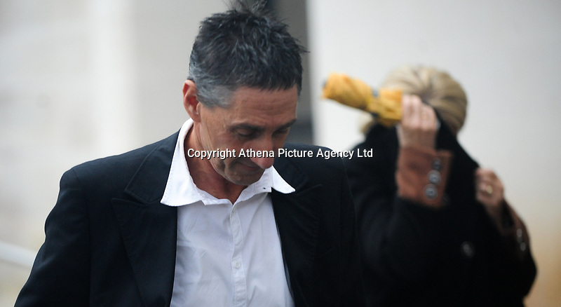 """Pictured: Anthony Mallon leaves Swansea Crown Court.<br /> Re: A long-running neighbourly dispute saw one man attack another with a JCB digger, Swansea Crown court has heard.<br /> The alleged victim was trapped against a wall by the earth-mover during the incident, and said he """"feared for his life"""".<br /> The Court heard the dispute between neighbours Bobby Vijay and Tony Mallon had rumbled on for more than a decade, with both parties making numerous calls to police in that time.<br /> The men owned neighbouring plots of land in Glanamman, Carmarthenshire and the conflict between the pair revolved around the issue of a right of way, the court heard.<br /> Mallon, 55, denies assault occasioning actual bodily harm, and a racially aggravated public order matter which relates to a separate incident between the men some 10 months later when he is said to have called Mr Vijay """"a black boy""""."""
