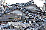 March 14, 2011, Sendai, Japan - A Japan Ground Self-Defense Force trooper stands in front of collapsed houses as search-and-rescue operations are launched near Sendai Airport, Miyagi prefecture, on Monday, March 14, 2011. The airport, located along the Pacific coast, was flooded by a 10-meter tsunami following a powerful earthquake with a magnitude of 9.0 that jolted northeastern Japanese cities on March 11, 2011. The death toll could reach 10,000 in the nation's worst and the world's fourth worst earthquake. (Photo by Natsuki Sakai/AFLO) [3615] -mis-.