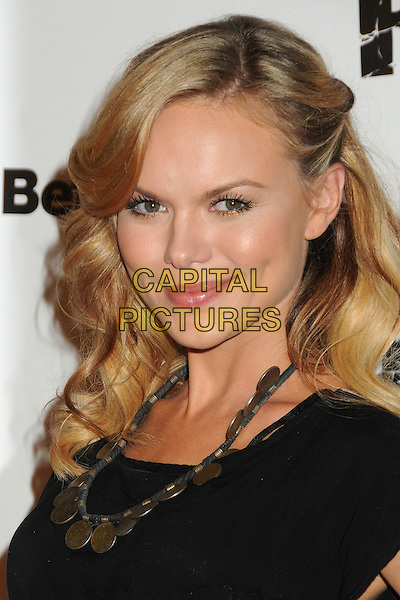 "Anya Monzikova.""Rage"" Video Game Launch Party held in Chinatown's Historical Central Plaza, Los Angeles, California, .30 September 2011..portrait headshot  black  top t-shirt gold necklace .CAP/ADM/BP.©Byron Purvis/AdMedia/Capital Pictures."