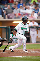 Dayton Dragons left fielder Taylor Trammell (5) follows through on a swing during a game against the Cedar Rapids Kernels on May 10, 2017 at Fifth Third Field in Dayton, Ohio.  Cedar Rapids defeated Dayton 6-5 in ten innings.  (Mike Janes/Four Seam Images)