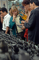 Tourists spend money at the site of the 2,200 year-old Terracotta Warriors near Xi'an, China. The 7,000 strong army of Terracota Warriors was unearthed in 1974 by a group of farmers digging a well. Many villagers from Yang village were forcibly aoved to make way for the new complex of tourist shops.