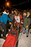 Lance Mackey is greeted by his mother and wife at the finish of the 2008 All Alaska Sweepstakes in Nome. Mackey took third place and arrived with a damaged sled and injured dog named Zoro, due to a snow machine collision about 20 miles from the finish line.