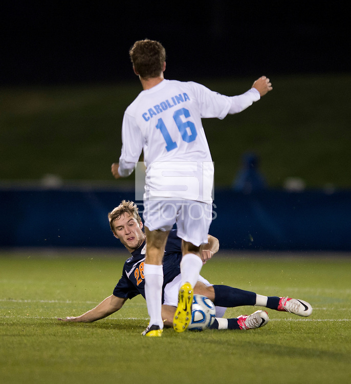 Rob Lovejoy (16) of North Carolina has the ball tackled away from him by Shane Cooke (28) of Virginia during the game at the Maryland SoccerPlex in Germantown, MD. North Carolina defeated Virginia on penalty kicks after playing to a 0-0 tie in regulation time.  With the win the Tarheels advanced to the finals of the ACC men's soccer tournament.