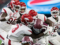 Hawgs Illustrated/Ben Goff<br /> McTelvin Agim (3), Arkansas defensive end, and De'Jon Harris, Arkansas linebacker, tackle Trayveon Williams, Texas A&M tailback, in the 1st quarter Saturday, Sept. 29, 2018, during the Southwest Classic at AT&T Stadium in Arlington, Texas.