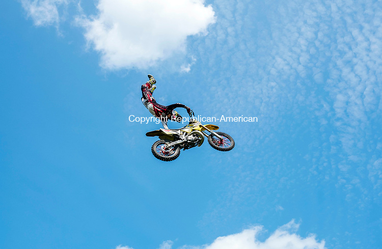 Bridgewater, CT- 19 August 2017-081917CM04-  Mike Angerman of Mays Landing, NJ compete glides through the air during the freestyle motorcross  show during the annual Bridgewater Fair on Saturday.  The fair concludes on Sunday, with gates opening at 8:00 a.m.  and closing at 6:00 p.m.      Christopher Massa Republican-American