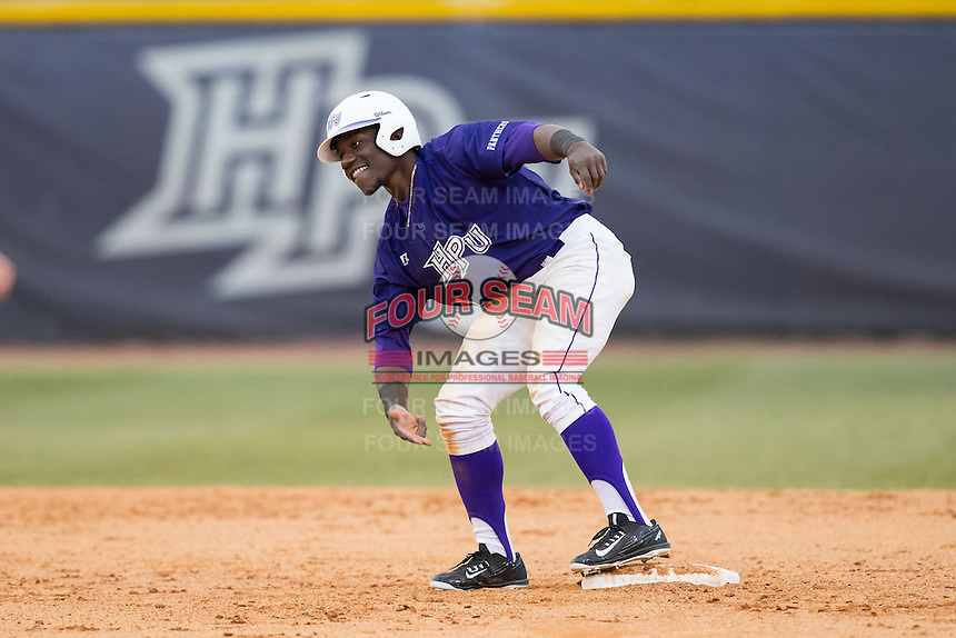 Josh Greene (1) of the High Point Panthers celebrates as he stands on second base during the game against the UNCG Spartans at Willard Stadium on February 14, 2015 in High Point, North Carolina.  The Panthers defeated the Spartans 12-2.  (Brian Westerholt/Four Seam Images)