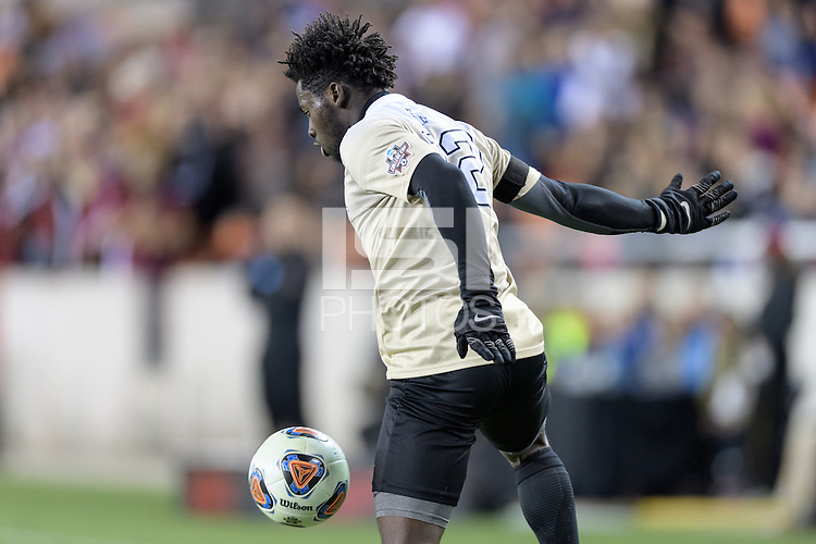 Houston, TX - Friday December 9, 2016: Ema Twumasi (22) of the Wake Forest Demon Deacons gains control of a loose ball in the first half against the Denver Pioneers  at the  NCAA Men's Soccer Semifinals at BBVA Compass Stadium.