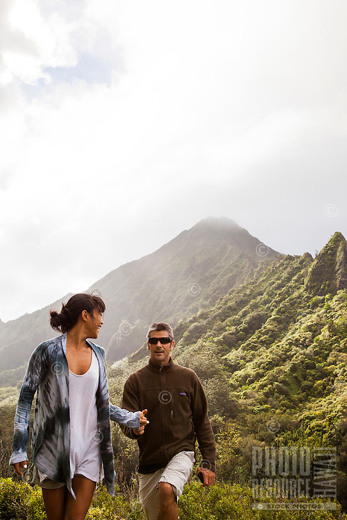 Happy couple trail hiking in Windward Oahu.