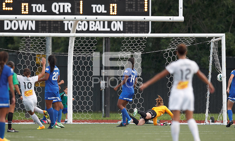 Western New York Flash midfielder Carli Lloyd (10) scores. In a National Women's Soccer League (NWSL) match, Boston Breakers (blue) tied Western New York Flash (white), 2-2, at Dilboy Stadium on August 3, 2013.