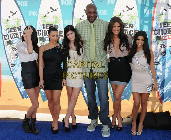 KENDALL JENNER, KOURTNEY KARDASHIAN, KIM KARDASHIAN, KYLIE JENNER, KHLOE KARDASHIAN ODOM & LEMAR ODOM.Arrivals - Fox Teen Choice 2010 Awards held at Universal Ampitheatre in Universal City, California, USA,.August 8th 2010..full length family sisters siblings black beige one sleeve dress white skirt green shirt tie married couple husband wife shoes trainers heels peep toe platform boots hand touching hair .CAP/RKE/DVS.©DVS/RockinExposures/Capital Pictures.