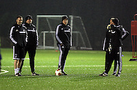 Swansea manager Garry Monk (C) surrounded by coaching staff during training