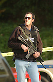 """Silver Spring, MD - October 22, 2002 -- FBI gunman looks around the area near where a 40 year-old man was shot on a Ride-on Bus in Aspen Hill, MD.   Police are treating the shooting as if it was by the """"Beltway Sniper"""".<br /> Credit: Ron Sachs / CNP                               <br /> (RESTRICTION: NO New York or New Jersey Newspapers or newspapers within a 75 mile radius of New York City)"""