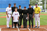 March 21, 2010:  Head Coach Rich Maloney (2) of the Michigan Wolverines with the umpires and Alumni Mike Cervenak of the NY Mets before a game at Tradition Field in St. Lucie, FL.  Photo By Mike Janes/Four Seam Images