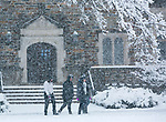 Duke students walk across the academic quad during a January snowfall of several inches.