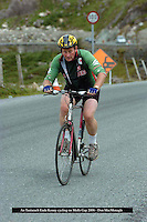 Not over the hill yet!.. Enda Kenny shows true grit as he cycles over Molls Gap on The Ring of Kerry during his holidays in 2006. He will back again on July 3rd when he will join over 3,000 cyclists on the 180km route in aid of various charities in the annual Ring of Kerry cycle. <br /> Picture by Don MacMonagle