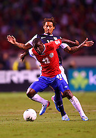 SAN JOSE, COSTA RICA - September 06, 2013: Jermaine Jones (13) of the USA MNT keeps away from Joel Campbell (12) of the Costa Rica MNT during a 2014 World Cup qualifying match at the National Stadium in San Jose on September 6. USA lost 3-1.