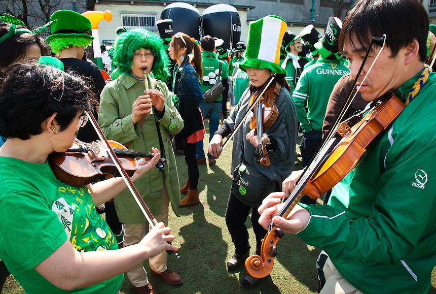 Japanese Irish band playing fiddles in St.Patrick's day Parade